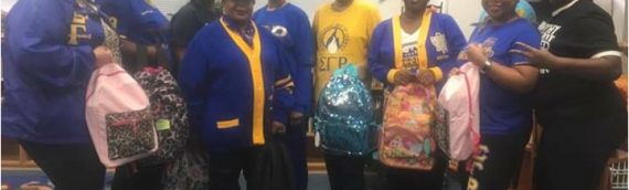 Sorority Distributes Book Bags & Supplies to STBCS